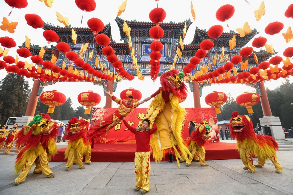BEIJING, CHINA - FEBRUARY 09: Chinese folk artists perform during the opening ceremony of the Spring Festival Temple Fair at the Temple of Earth park on February 9, 2013 in Beijing, China. The Chinese Lunar New Year of Snake also known as the Spring Festival, which is based on the Lunisolar Chinese calendar, is celebrated from the first day of the first month of the lunar year and ends with Lantern Festival on the Fifteenth day. (Photo by Feng Li/Getty Images) ORG XMIT: 160395911
