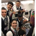 Newborn baby with the Turkish Airlines flight staff