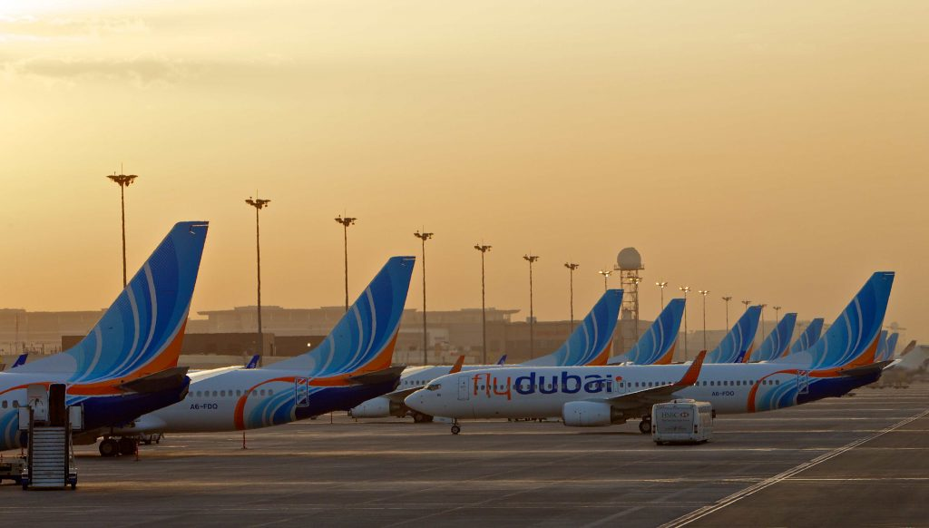 Aircraft pushing back from a row at the gate