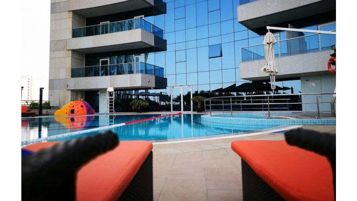 laze-around-the-outdoor-swimming-pool-with-kids-dedicated-pool-and-play-equipment