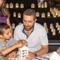 Families building LEGO lanterns