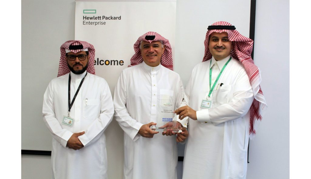 Photo Caption Mr. Ali Alireza NATCOM Chairman receives the awards from Mr