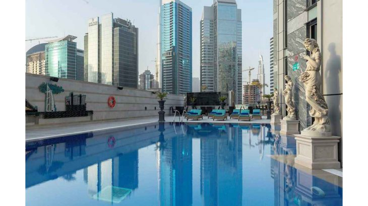 grand-millennium-business-bay_swimming-pool-with-statues-resized