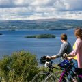 Cyclists enjoying a spectacular view overlooking Lough Derg