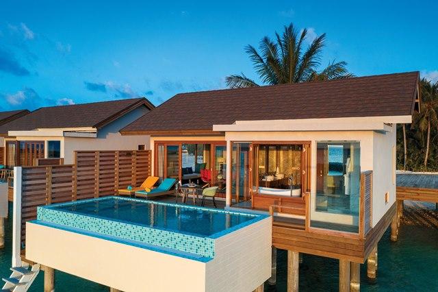 ATMOSPHERE KANIFUSHI MALDIVES - WATER VILLA WITH POOL - EXTERIOR VIEW AT SUNSET 02