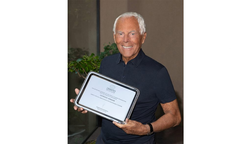 Giorgio_Armani_with_the_UNTWO_plaque_Courtesy_of_Giorgio_Armani
